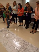 Teacher candidates used a Kentucky floor map to plot the Lewis and Clark journey.