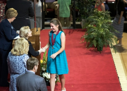 Julia Roberts, executive director of The Center for Gifted Studies and The Gatton Academy, greets students after they receive medals during the Duke TIP ceremony May 22. (Photo by Samual Oldenburg)