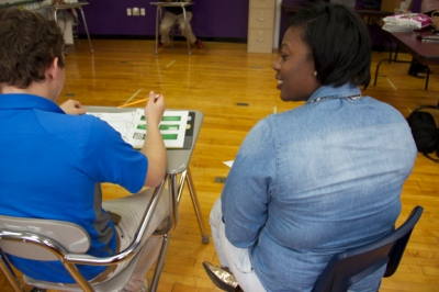 WKU graduate assistant Keira Martin works with a student at the Academy at Eleventh Street as part of the ALIVE Center's Project L.I.F.E. program.