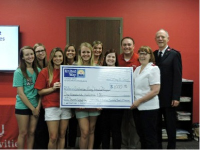 Student United Way members and advisors presented the $1,000 grant to the Captain Love and Mrs. Love of The Salvation Army.