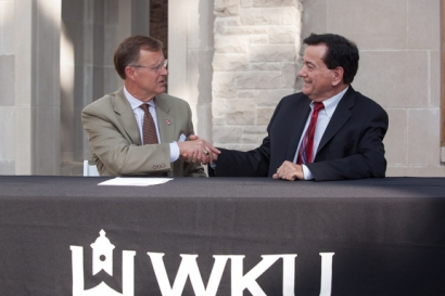 WKU President Gary Ransdell (left) and ESLi President and Owner Gary Bartholomew shake hands after signing a new five-year agreement on July 21. (WKU photo by Clinton Lewis)