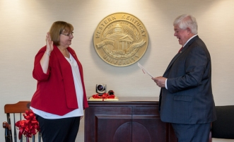 Staff Regent Tamela W. Smith was sworn in by Board of Regents Chair Frederick A. Higdon. (WKU photo by Clinton Lewis)