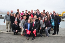 Ambassador Stewart Wheeler of Canada and Robert Barber of the United States (front) posed with the WKU study abroad group in Iceland and showed honorary Hilltopper pride with their red towels.