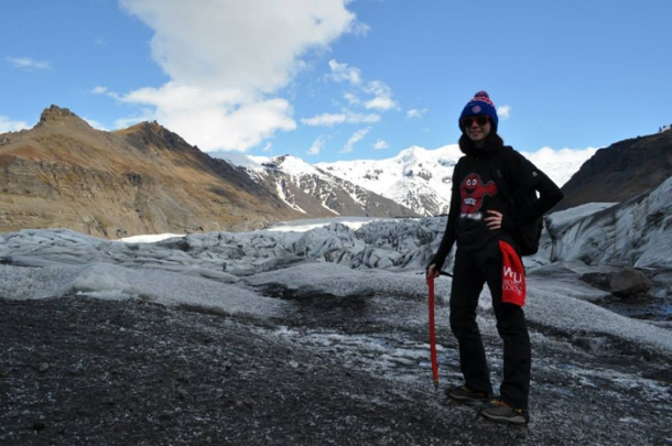WKU student Tara Sorrels on top of Svinafellsjokull glacier tongue, which the Climate Change Challenge Study Abroad Group explored prior to the start of her internship and research endeavors in Iceland.