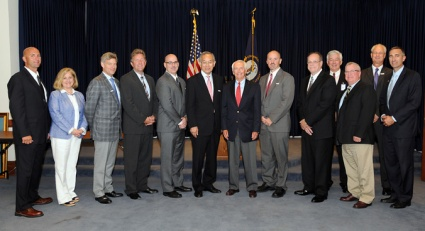 A large contingent of officials from the Glasgow area traveled to Frankfort last month to meet with Gov. Beshear to discuss the group's work. Included in the group were (from left):  Barren County Judge-Executive Micheal Hale, WKU Glasgow Regional Chancellor Sally Ray, Glasgow Mayor Dick Doty, Rep. Johnny Bell, Akebono Brake Glasgow Plant Manager Jeff Simons, Akebono Brake Corporation President & CEO Yoshimasa Ogino, Gov. Beshear, Akebono Brake Glasgow HR Manager Michael Blackburn, HRD Consultant Michael Lovett, BRADD Executive Director Rodney Kirtley, HRD Senior Analyst Robert Cobb, Executive Director Barren County IDEA Dan Iacconi and Sen. David Givens. (Photo by LRC Public Information)