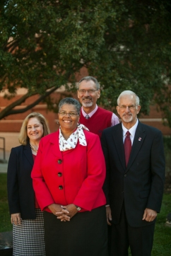 WKU Regional Chancellors (left to right) Sally Ray, Evelyn Ellis and Gene Tice and Associate Provost for Regional Higher Education Dennis George (back)
