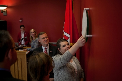 Madison Thomas, president of WKU USGBC Students, unveiled the LEED certified plaque at Gary Ransdell Hall during a recognition ceremony on Oct. 28. (WKU photo by Bryan Lemon)