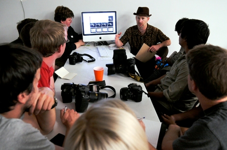 Photojournalism coach Rick Loomis talks to his team while writing coach Lynne Warren looks on during the Mayfield workshops. (©2008 Nina Greipel / The Mountain Workshops)