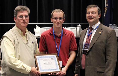 WKU student Ryan Uthoff (center) received the KAMP GIS scholarship from KAMP President Lance Morris (left) and his advisor Kevin Cary (right). (Photo by Christy Powell)
