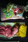 Kierney Wilson, 3, bottom, and Kiley Engard, 3, take their naps at Little Angels Day Care in Mayfield. The day care center is operated by Lisa West, assisted by her three daughters. ©2008 Scott McIntyre