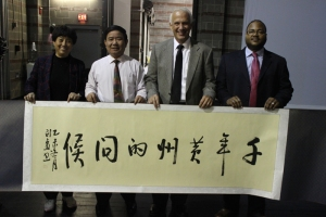 World-renowned calligrapher Chen Xunjin presented Thomas Stites, coordinator of Fine Arts for OPS, with a calligraphy piece that was done during the performance at the RiverPark Center.