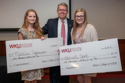 Scholar of the Week scholarships were presented to Madeline Stephenson (left) and Gabrielle Short (right) by Dr. Craig T. Cobane, executive director of the Honors College at WKU. (WKU photo by Bryan Lemon)