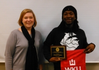 WKU student Jefferson Sanders (right) received an undergraduate library research award from Sara McCaslin, University Experience Coordinator.