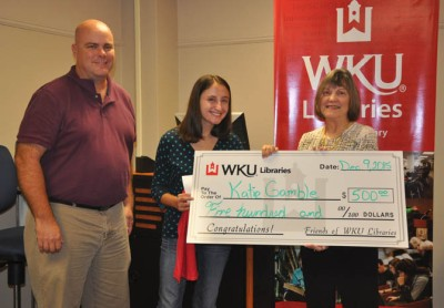 Katie Gamble (center) received the WKU Library Student Assistant Scholarship. The award was presented by Doug Wiles (left) and Connie Foster, dean of University Libraries.