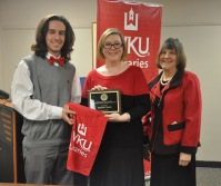 WKU student Daulton Cowan (left) received an undergraduate library research award from Sara McCaslin, University Experience Coordinator, and Dr. Connie Foster, (right) Dean of University Libraries.