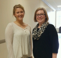 WKU student Maggie Flanagan (left) was congratulated by Sara McCaslin, University Experience Coordinator, for winning an undergraduate library research award.