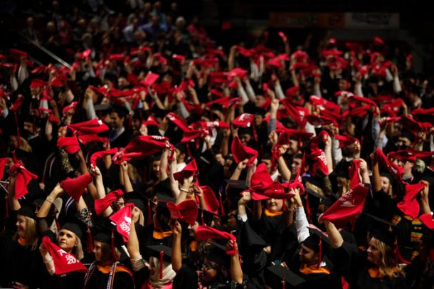 The Class of 2015 waved red towels at the conclusion of WKU's 178th Commencement on Dec. 12. (WKU photo by Bryan Lemon)