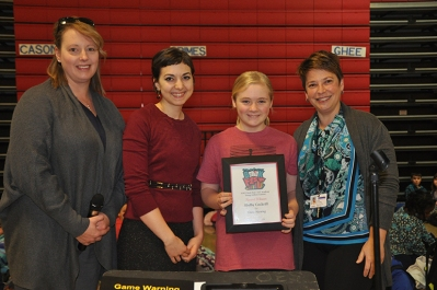 Shelby Cockrill (third from left), a sixth-grader at Oakland Elementary School, was honored as a winner in the SOKY Book Fest -- 212° Academy Young Authors Contest. Making the presentation (from left) were Barnes & Noble Manager Jennifer Bailey, Literary Outreach Coordinator Sara Volpi and 212° Academy teacher Jennifer Sheffield.