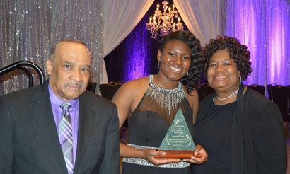 Gatton Academy senior Rachel Cooper (center) received the YMCA of Greater Louisville's 2016 Black Achievers Youth Achiever of the Year award. She is pictured with family members David Cooper (left) and Carolyn Miller-Cooper (right).