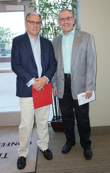 "Paul Griner (left) is the 2016 recipient of the Kentucky Literary Award for his book ""Hurry Please, I Want to Know."" Pictured with Griner is Jonathan Jeffrey, head of WKU Library Special Collections and a member of the selection committee for the award."