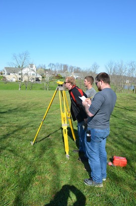 Surveying competition (left to right) Daniel Hammer, Jacob Cornett, and Nathan Hughes (front).