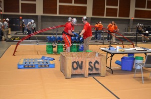 Steel bridge being load tested at the regional competition. Daniel Hammer (back), Nathan Hughes and James Thomason.