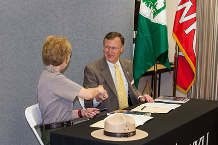 WKU President Gary Ransdell shakes hands with Mammoth Cave National Park Superintendent Sarah Craighead after the two signed a general agreement Monday that provides the framework for continued research collaboration. The ceremony opened the 11th Research Symposium that continues through Wednesday. (WKU photo by Bob Skipper)