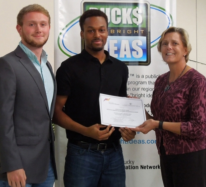 From left: Collin Kemp and Devonte Jones accept their award certificate from Lynn Minton, Assistant Director of the Kentucky Innovation Network, during the Bucks for Bright Ideas Awards Banquet on May 4 at WKU's Center for Research and Development.