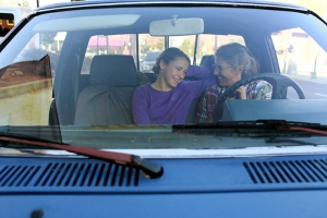 Ella Lemley (left), 14, and her mother, Connie, laugh in their pickup truck. Connie, who homeschools Ella, also teaches a math class to a group of local homeschooled students.