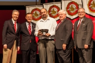 Dr. Timothy Rich (center) received the University Award for Research and Creativity. Participating in the presentation (from left) were: Provost David Lee, President Gary Ransdell, Regents Chair Freddie Higdon and Marc Archambault, Vice President for Development and Alumni Relations. (WKU photo by Clinton Lewis)
