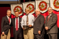 Dr. David LeNoir (center) received the University Award for Student Advisement.. Participating in the presentation (from left) were: Provost David Lee, President Gary Ransdell, Regents Chair Freddie Higdon and Marc Archambault, Vice President for Development and Alumni Relations. (WKU photo by Clinton Lewis)