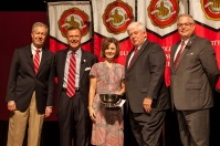 Laura Houchens (center) received the University Part-Time Faculty Award. Participating in the presentation (from left) were: Provost David Lee, President Gary Ransdell, Regents Chair Freddie Higdon and Marc Archambault, Vice President for Development and Alumni Relations. (WKU photo by Clinton Lewis)
