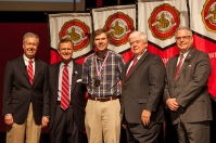 Dr. Tom Richmond (center) was recognized as University Distinguished Professor. Participating in the presentation (from left) were: Provost David Lee, President Gary Ransdell, Regents Chair Freddie Higdon and Marc Archambault, Vice President for Development and Alumni Relations. (WKU photo by Clinton Lewis)