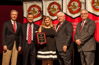 Allison Smith (center) received the Staff Excellence Award for Administrative Professional/Non-Faculty. Participating in the presentation (from left) were: Provost David Lee, President Gary Ransdell, Regents Chair Freddie Higdon and Marc Archambault, Vice President for Development and Alumni Relations. (WKU photo by Clinton Lewis)