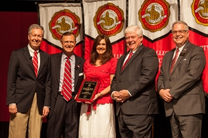 Stephanie Scott (center) received the Staff Excellence Award for Administrative Support. Participating in the presentation (from left) were: Provost David Lee, President Gary Ransdell, Regents Chair Freddie Higdon and Marc Archambault, Vice President for Development and Alumni Relations. (WKU photo by Clinton Lewis)