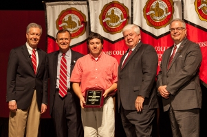 Kevin Gutierrez (center) received the Staff Excellence Award for Building Services.Participating in the presentation (from left) were: Provost David Lee, President Gary Ransdell, Regents Chair Freddie Higdon and Marc Archambault, Vice President for Development and Alumni Relations. (WKU photo by Clinton Lewis)