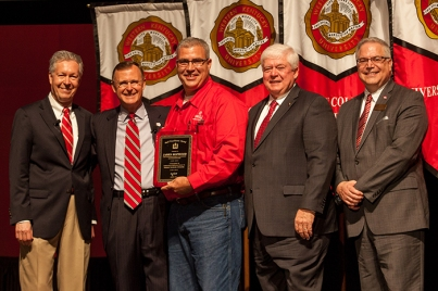 James Hopwood (center) received the Staff Excellence Award for Skilled/Technical/Paraprofessional. Participating in the presentation (from left) were: Provost David Lee, President Gary Ransdell, Regents Chair Freddie Higdon and Marc Archambault, Vice President for Development and Alumni Relations. (WKU photo by Clinton Lewis)