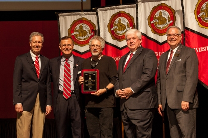 """Jeff """"Smitty"""" Smith (center) received the Spirit of Western Award. Participating in the presentation (from left) were: Provost David Lee, President Gary Ransdell, Regents Chair Freddie Higdon and Marc Archambault, Vice President for Development and Alumni Relations. (WKU photo by Clinton Lewis)"""