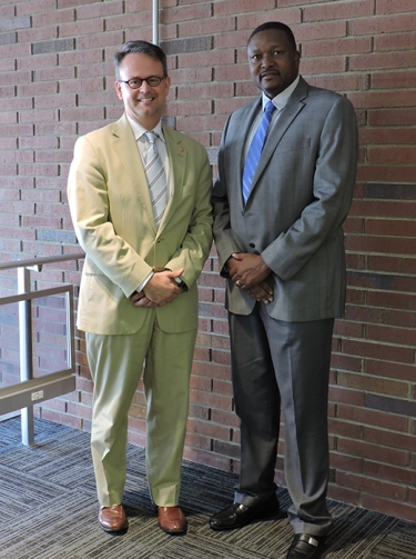 """Dr. Neale Chumbler (left), dean of WKU's College of Health and Human Services, and Dr. William Mkanta, associate professor in WKU's Department of Public Health, led a research project on """"Cost and Predictors of Hospitalizations for Ambulatory Care - Sensitive Conditions Among Medicaid Enrollees in Comprehensive Managed Care Plans."""""""