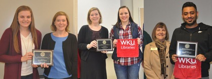 WKU students (from left) Elizabeth Hurm, Susannah Roy and Mahdi Alawami received undergraduate research awards. Sara McCaslin, University Experience Coordinator, is pictured with Hurm and Roy; Connie Foster, Dean of WKU Libraries, is pictured with Alawami.