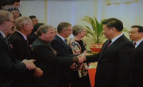 In an image captured from China's television station CCTV, WKU Professor Chris Groves is congratulated by China's President Xi Jinping and Premier Li Keqiang (right) at China's National Science and Technology Award Ceremony on Monday in Beijing.