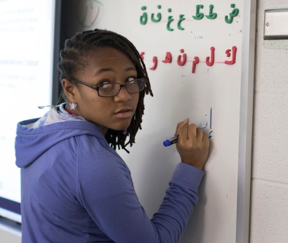 Aderdo Brooks of Washington, D.C,. practices her writing skills in the Arabic class during the Summer Program for Verbally and Mathematically Precocious Youth (VAMPY) in 2015. (Photo by Emilie Milcarek)