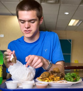 Jake Bowen of Ekron eats Middle Eastern and Mediterranean food at an international restaurant in Nashville during a field trip as part of the Summer Program for Verbally and Mathematically Precocious Youth (VAMPY) in 2016. (Photo by Tucker Allen Covey)