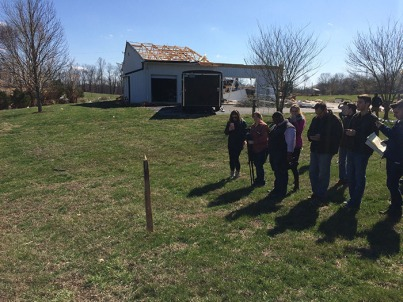 WKU meteorology students observed a broken piece of wood that penetrated the ground during the March 1 storm.
