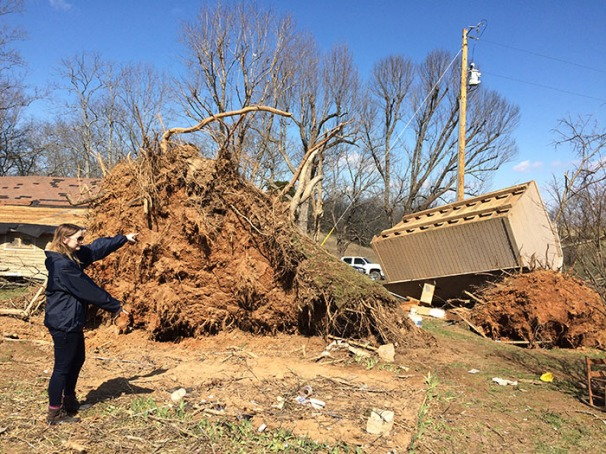 Melissa Moore from Warren County Emergency Management highlighted the placement of a shed before the tornado toppled a large tree and tossed the shed.