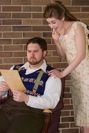 Gianni Schicchi, played by Frankfort senior Dylan Wright, and Lauretta, his daughter, played by Owensboro senior Hadley Rouse, examine the will of Buoso Donati.