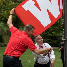 Coach Mike Sanford and President Timothy C. Caboni raised the W on Aug. 30 at the President's Home.