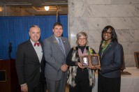 Cari Marshall (third from left) accepted the Kentucky Hall of Fame award on behalf of her mother Gloria Compton. Participating in the Feb. 6 presentation were (from left) WKU President Timothy C. Caboni, Kentucky Education Commissioner Stephen Pruitt and Lt. Gov. Jenean Hampton.