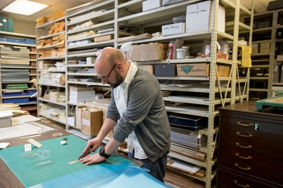 Joe Shankweiler is working to build supports and displays for WKU's tiny book collection.